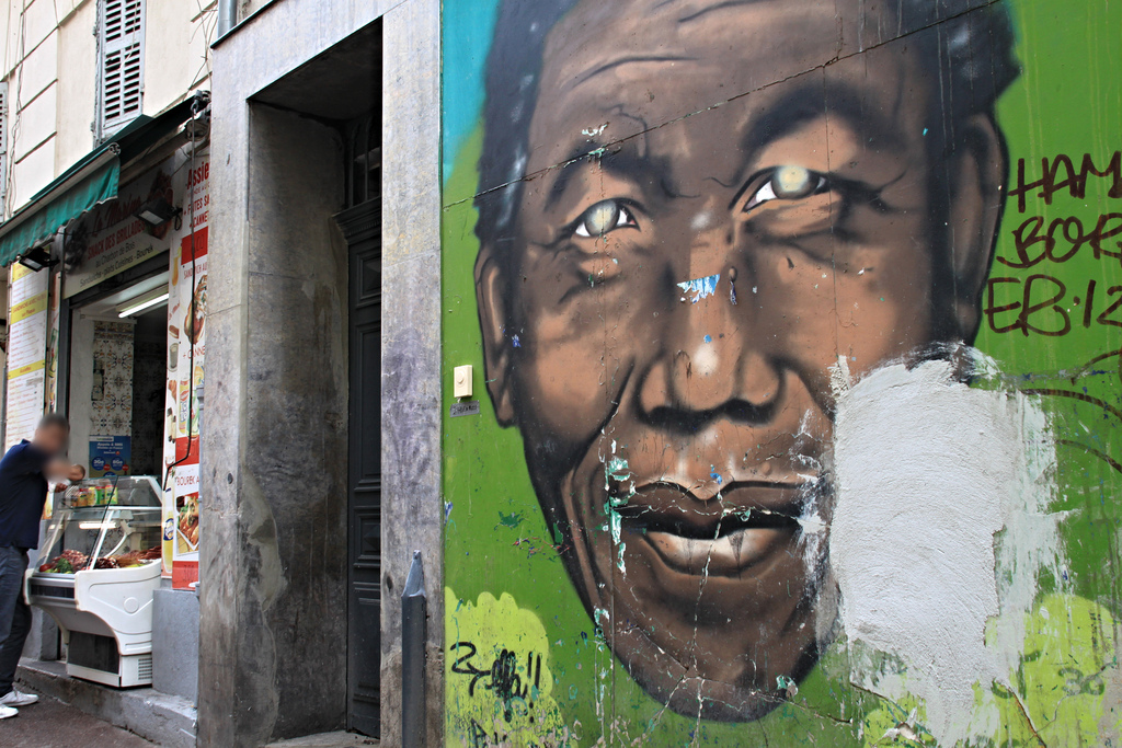 A Street Art of Nelson Mandela in the neighbourhood of Noailles in Marseille. The neighbourhood is known for derelict housing.