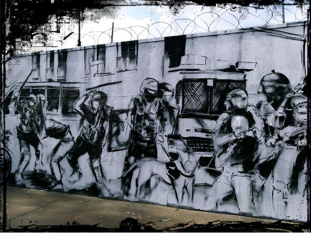 Streetart-mural. Black and white drawing on which police officers beating a manifestant can be seen.