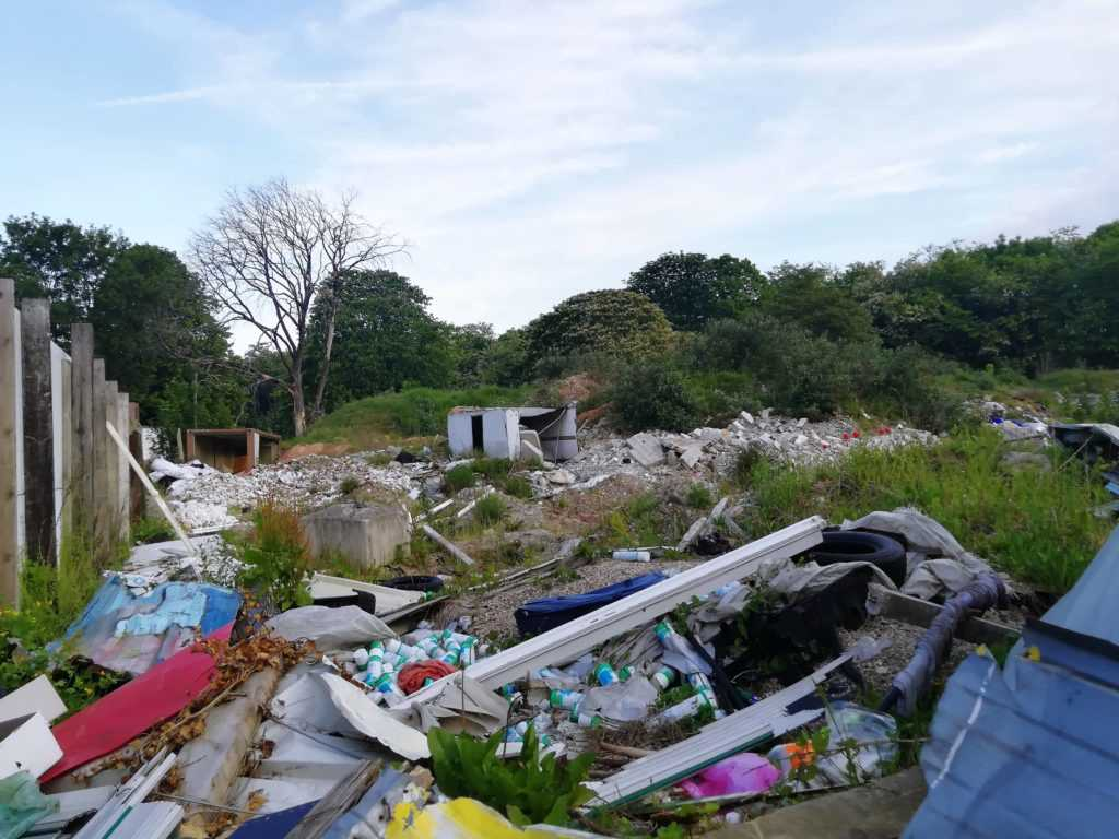 illegal dump, paris suburb, banlieue, trash, litter, blue sky, public parc nearly
