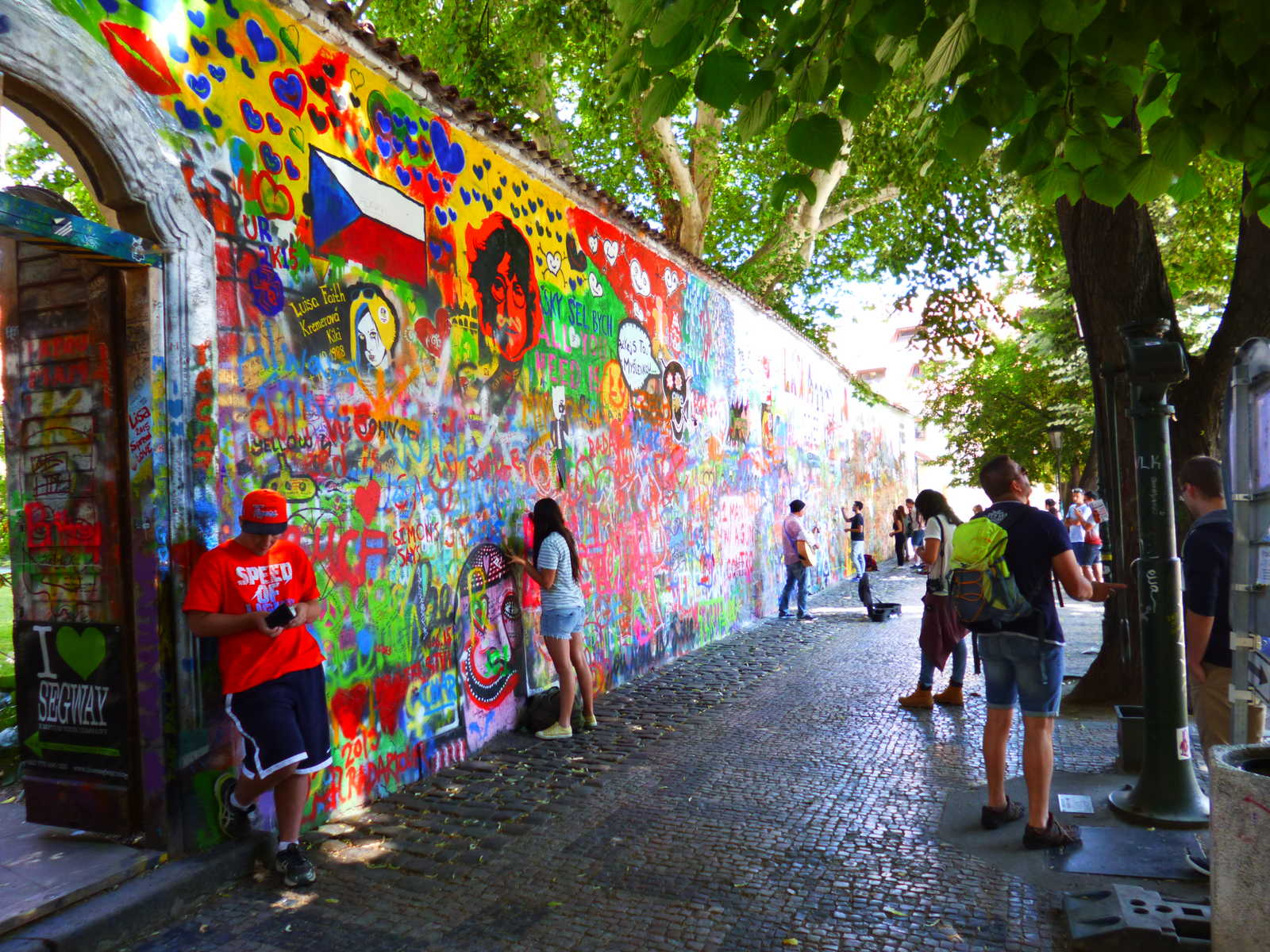 John Lennon Wall with tourists in the Old Town of Prague.